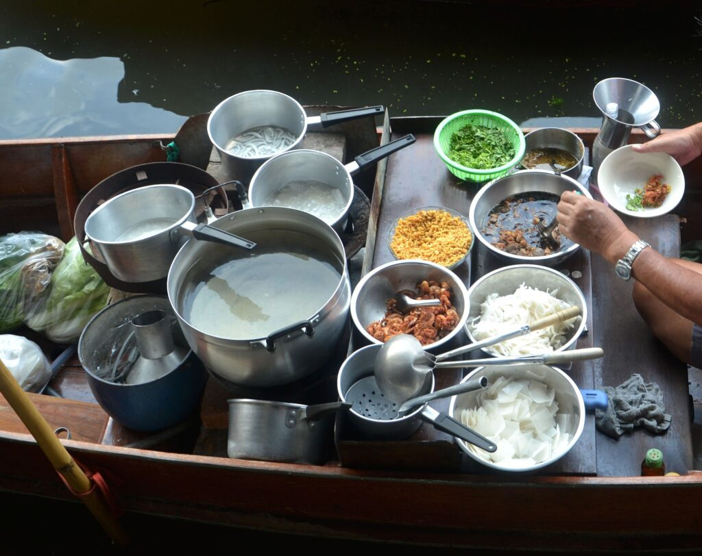 removable handle cookware on a wooden boat